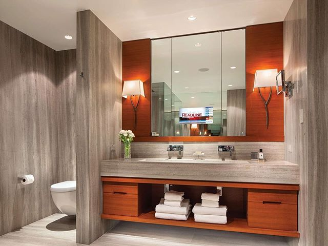 Whistler renovation throwback to a job i managed with EVR / VP  in 2011 before forming MCC . Master ensuite Designed by Mitchell Freedland . Mike Maca custom sconces / Jatoba veneer and cabinets by Seagull millworks / linear travertine Slabs @aeonstonetile . . .