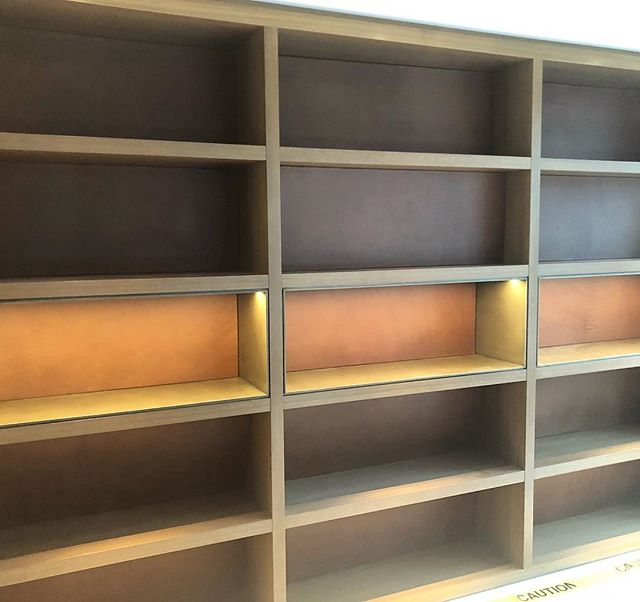 Fabulous office Bookshelf.  Leather by @bloomfurniturestudio  accent row of brass by @drabektechnologiesltd .Designed by Aaron MacKenzie Moore . . . . . . . . .