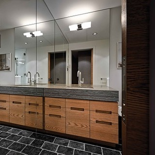 2014 throwback to a Whistler Reno . Simple Rustic Modern ensuite . Rift cut white Oak with a raw wire brush finish Millwork by Seagull / Acid washed brushed and tumbled blue pavers by @stonetilevancouver / Marble stone countertops by @bordignonmarbleandgranite .  Designed by Mitchell Freedland . . .