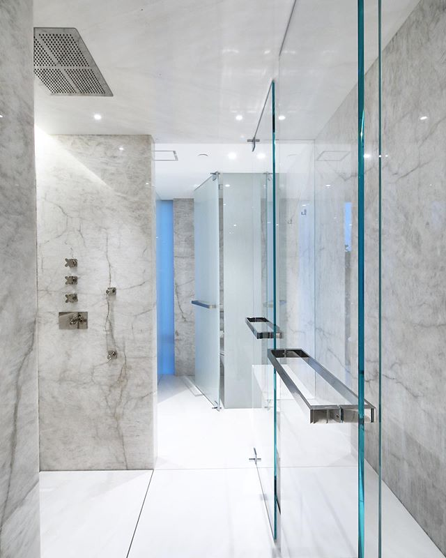 This master En-suite that keep giving. The amount of work that went into to pulling off some of these exploratory details. • Slabs and Slabs and more slabs •This shower floor is on pedestals with 1/4 reveals to the drain. • Many broken slabs to CNC out all but 1/16 to pull off @flexalightingna trim-less lights epoxied into the ceiling slabs. • finishing it off with an end to end heated bench.  Designed by @aaron_mackenzie_moore